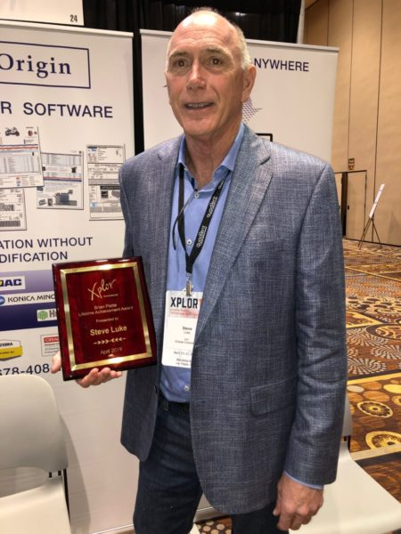 Steve Luke, Founder and CEO of Eclipse Corp displays the Brain Platte Lifetime Achievement Award he received at Xplor 19